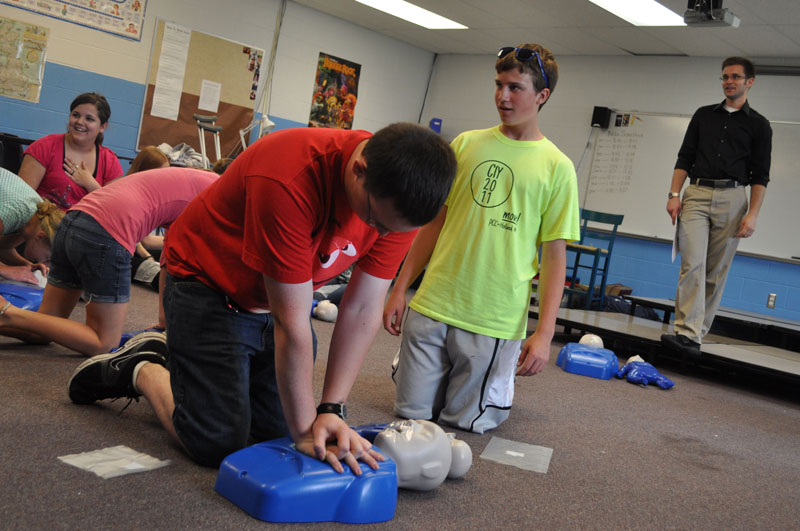 Performing CPR on dummy at Algoma Christian